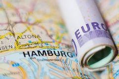 Euro banknotes on a geographical map of Hamburg Royalty Free Stock Photo