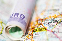Euro banknotes on a geographical map of Madrid Royalty Free Stock Photos