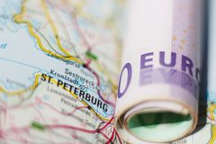 Euro banknotes on a geographical map of Saint Petersburg Stock Photography