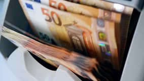 Euro banknotes are getting calculated on a machine. 4K stock video