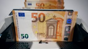 Euro banknotes are getting counted by an automatic device. 4K stock video footage