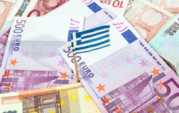 Euro banknotes and Greek flag Stock Photos