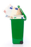 Euro banknotes in green wheelie bin Stock Photos