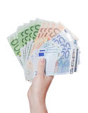Euro banknotes in a hand. Euro banknotes in hand isolated on white Stock Images