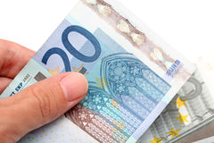 Euro banknotes in hand. Against white background. Close-up Stock Image