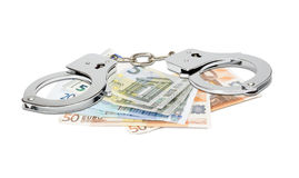 Euro banknotes and handcuffs. Isolated on white Stock Photography