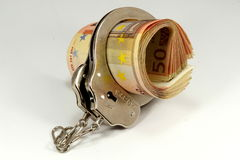 Euro banknotes and handcuffs Stock Photo