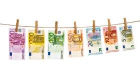 Euro banknotes hanging clothes pins Money laundering. Euro banknotes hanging a rope with clothes pins. Money background. Money laundering concept Stock Image
