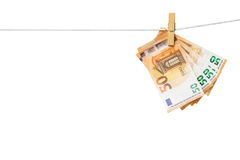 50 Euro banknotes hanging on clothesline. Money laundering concept -Euro banknotes hanging on clothesline isolated on white, included clipping path Stock Images