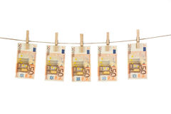 50 Euro banknotes hanging on clothesline on white background. Money laundering concept Stock Photo