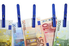 Euro banknotes hanging on laundry line Royalty Free Stock Photos