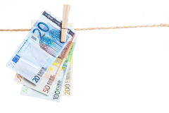 Euro banknotes hanging from a rope Royalty Free Stock Images