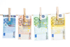 Euro banknotes hanging from a rope Royalty Free Stock Photography