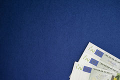 Euro banknotes heap on a blue background Royalty Free Stock Photo