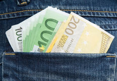 Euro banknotes in hip-pocket of jeans Royalty Free Stock Image
