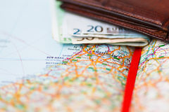 Euro banknotes inside wallet on a geographical map of Amsterdam Royalty Free Stock Photography