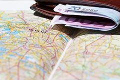 Euro banknotes inside wallet on a geographical map of Berlin Stock Photos