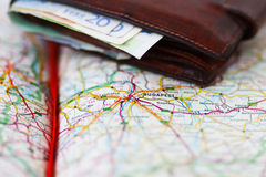 Euro banknotes inside wallet on a geographical map of Budapest Stock Photography