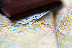 Euro banknotes inside wallet on a geographical map of Cologne Stock Photos