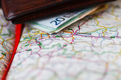 Euro banknotes inside wallet on a geographical map of Krakow Royalty Free Stock Photography