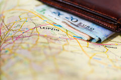 Euro banknotes inside wallet on a geographical map of Leipzig Royalty Free Stock Image