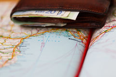 Euro banknotes inside wallet on a geographical map of Marseille Royalty Free Stock Image