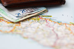 Euro banknotes inside wallet on a geographical map of Palermo Stock Photos