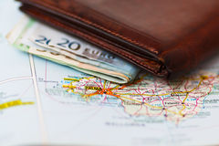 Euro banknotes inside wallet on a geographical map of Palma Royalty Free Stock Photography