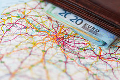 Euro banknotes inside wallet on a geographical map of Paris Royalty Free Stock Image