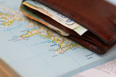 Euro banknotes inside wallet on a geographical map of Reykjavik Royalty Free Stock Image