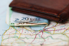 Euro banknotes inside wallet on a geographical map of Riga Royalty Free Stock Photography