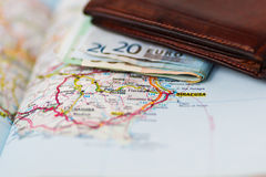 Euro banknotes inside wallet on a geographical map of Siracusa Royalty Free Stock Photos