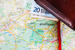Euro banknotes inside wallet on a geographical map of Stuttgart Royalty Free Stock Images