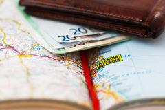 Euro banknotes inside wallet on a geographical map of Valencia Royalty Free Stock Images