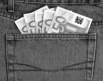 50 euro banknotes in jeans pocket black and white. 50 euro banknotes in jeans pocket black and white Royalty Free Stock Image