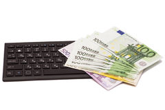 Euro banknotes on keyboard Royalty Free Stock Photo