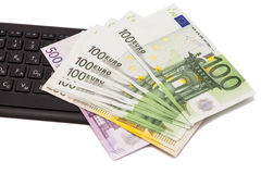 Euro banknotes on keyboard Royalty Free Stock Images