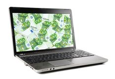 Euro banknotes on laptop display royalty free stock images