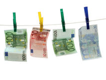 Euro Banknotes on Laundry Rope. Two 100 Euro bills and one 20 and 10 Euro note on white rope. Concept of Money Laundry Stock Images