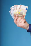 Euro banknotes in male hand Royalty Free Stock Image