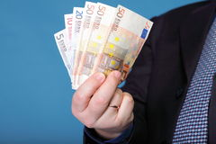 Euro banknotes in male hand Stock Images