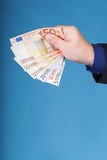 Euro banknotes in male hand Stock Image