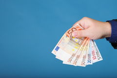 Euro banknotes in male hand Royalty Free Stock Photos