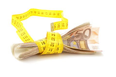 Euro banknotes with measure tape Stock Image