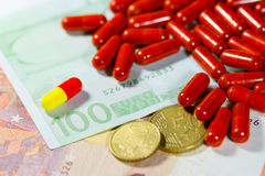 Euro banknotes with medical pills Stock Image