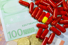 Euro banknotes with medical pills Royalty Free Stock Photos