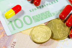 Euro banknotes with medical pills Stock Photo
