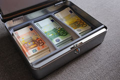 Euro banknotes in metal box Royalty Free Stock Images