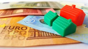 Euro Banknotes and Mini Houses stock images