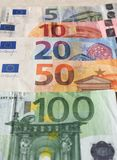 Euro notes, European Union. Euro banknotes money (EUR), currency of European Union, full range including five, ten, twenty, fifty and one hundred euros Royalty Free Stock Photo